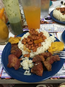 Carne Frita, rice, beans and tostones.